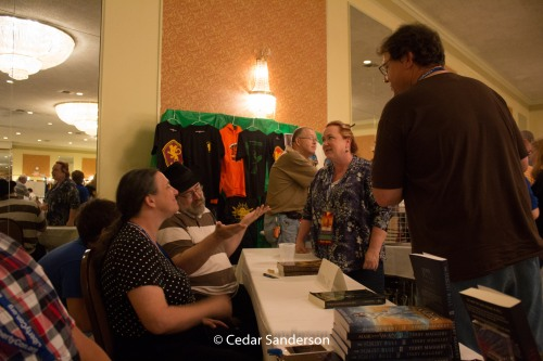 L Jagi Lamplighter and John C Wright at the autograph table with fans.